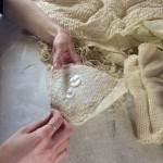 Clare begins by weaving the fabric then sewing a fabric cup.