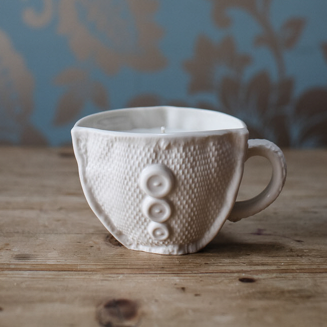 Button candle cup